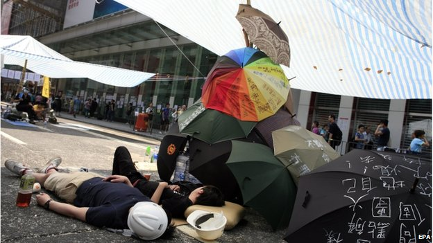 Pro-democracy protesters take a rest during the mass civil disobedience campaign Occupy Central in Mong Kok shopping area, Hong Kong, China, 8 October 2014.