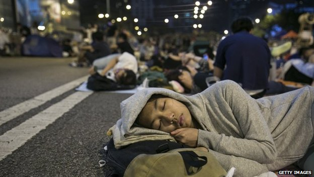 Protesters sleep at a protest site in tents in Hong Kong, 11 October 2014