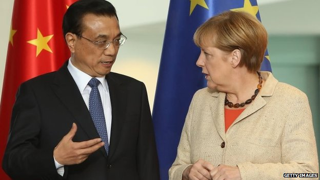 Li Keqiang, premier of the People's Republic of China and German Chancellor Angela Merkel arrive for a signing ceremony during German-Chinese government consultations in Berlin, Germany, 10 October 2014