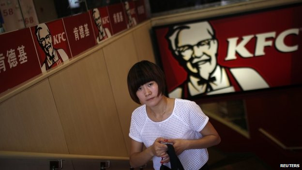 A customer walks out of a KFC store in downtown Shanghai on 31 July  2014