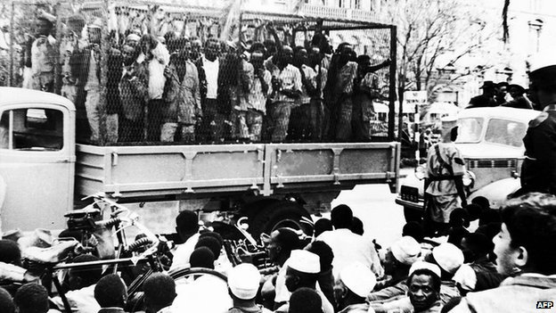 "Some of the hundreds of Mau Mau suspects who were rounded up in Nairobi, Kenya, on 21 October 1952, are taken away for interrogation in a police ""cage""."