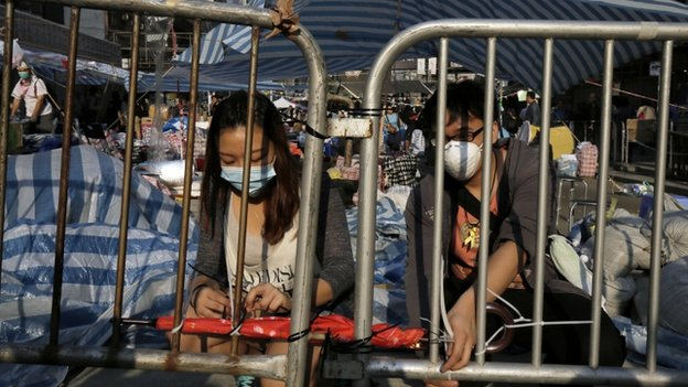 Protesters set up barricades again after police removed them in Causeway Bay district in Hong Kong Tuesday, Oct. 14, 2014.