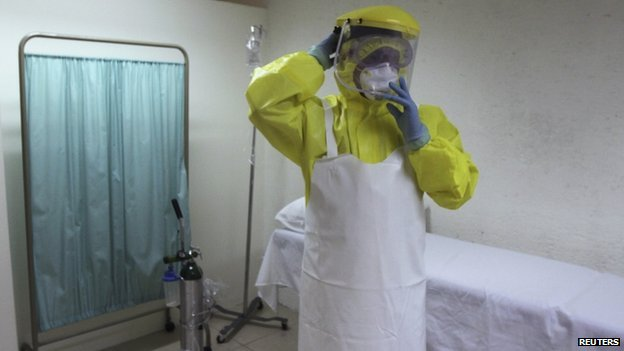 A health worker uses a protective suit during a presentation for the media at the international airport in Guatemala City 13 October 2014.