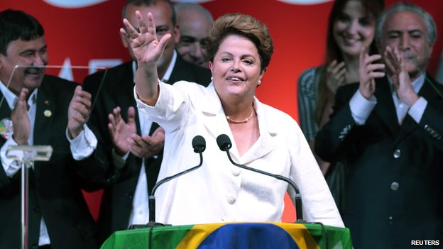 Dilma Rousseff reacts during news conference after the disclosure of the election results in Brasilia, October 26, 2014.