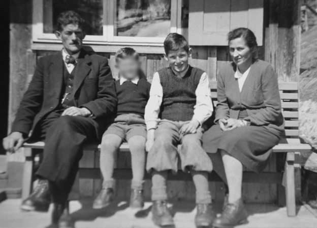 David with his foster family and another unidentified boy