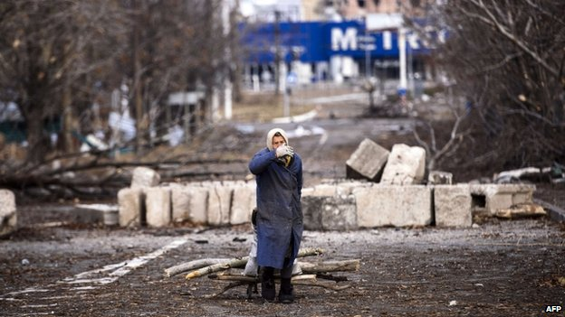 An elderly woman pulls a cart with firewood near the Donetsk airport. Photo: 3 November 2014