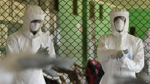 Ebola healthcare workers are trained on ways to treat infected patients at the Siaka Stevens Stadium in Freetown, Sierra Leone, 12 November 2014