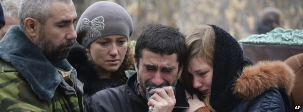 Mourners at the funeral on 7 November of two schoolboys killed by shelling in Donetsk