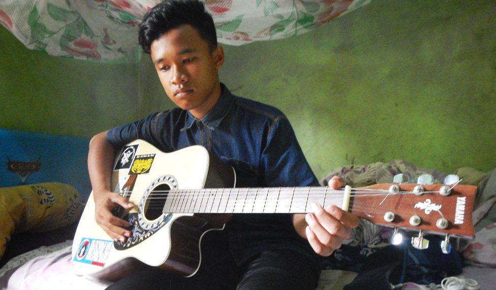 Brother with guitar
