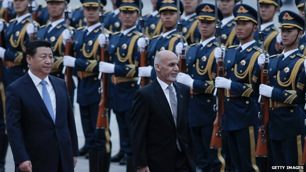 Chinese President Xi Jinping (L) accompanies Afghan President Ashraf Ghani (R) to view an honour guard during a welcoming ceremony outside the Great Hall of The People on 28 October 2014 in Beijing, China.
