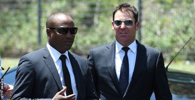 Brian Lara (left) and Shane Warne arrive for the service