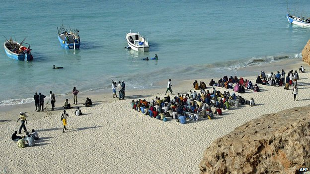 File photo:  Illegal Somali and Ethiopian migrants wait to embark on boats on a voyage to Yemen on Shinbivale beach, 17 kms, east of Bosasso, Somalia, 7 September 2007