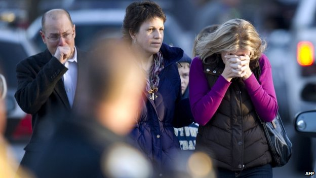 Distraught people appeared in Newtown, Connecticut, on 14 December 2012