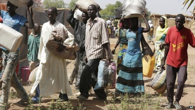 Civilians who fled their homes following an attack by Islamist militants, in Gwoza arrived at the camp for internally displaced people in Yola, Nigeria, on 27 November 2014