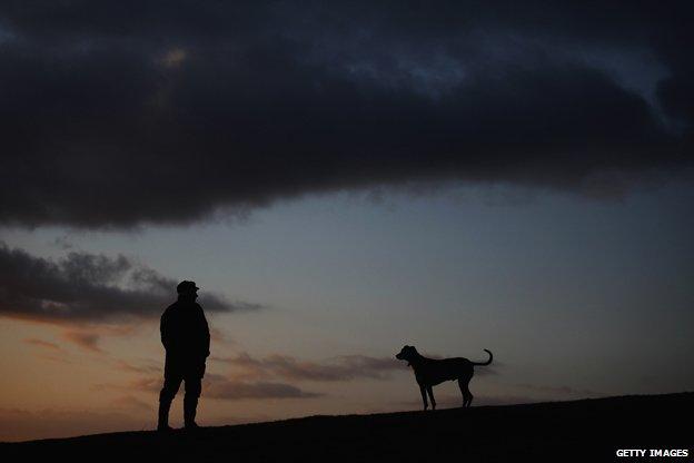 Man and dog on dark winter morning