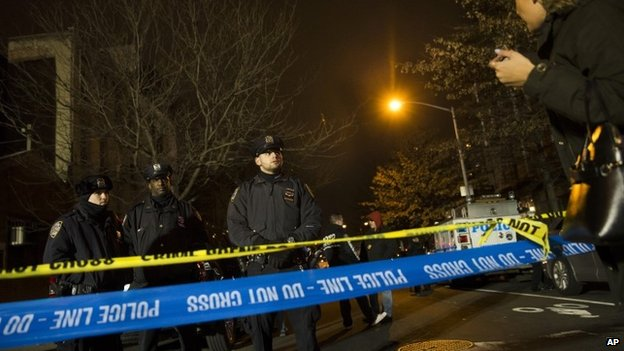 Police guard the scene where two NYPD officers were shot on 20 December 2014 in New York