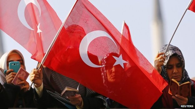 Supporters of the Gulen movement wave Turkish flags as they gather outside the Justice Palace in Istanbul - 19 December 2014