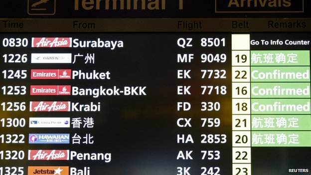 The flight arrivals board at Changi Airport in Singapore, where the AirAsia flight was due