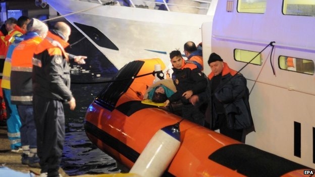 """Rescue operations evacuating some of passengers from the Norman Atlantic ferry on a """"Capitaneria di Porto"""" patrol boat in the harbour of Otranto, Italy, 28 December 2014."""