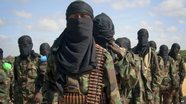 Armed members of the militant group al-Shabab attend a rally on the outskirts of Mogadishu, Somalia in this February 2012 file photo.