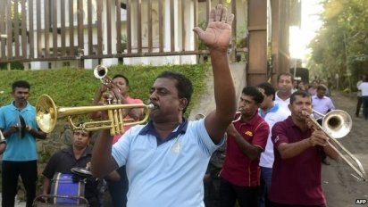 "Supporters of Sri Lanka's main opposition candidate Maithripala Sirisena play music as they celebrate in the streets of Colombo after Sri Lanka""s President Mahinda Rajapaksa conceded defeat on January 9"