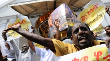 Sri Lanka supporters of the country's main opposition chant slogans and hold banners as they protest outside a casino in Colombo on April 24