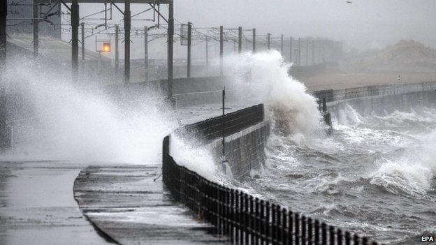 Waves crash against the sea wall on the Ayrshire coast