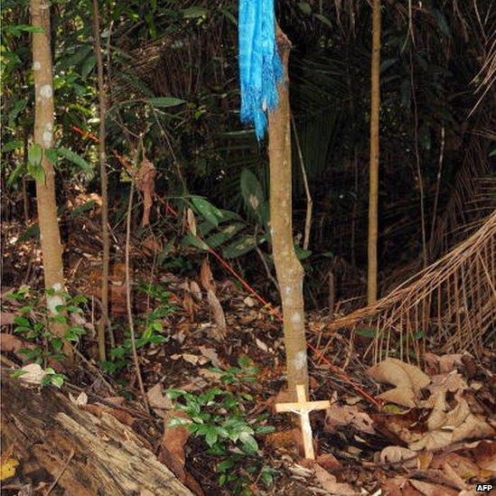 A crucifix lies at the crime scene in the forest where prosecutors allege Mongolian Altantuya Shaaribuu, 28, was murdered in Shah Alam, near Kuala Lumpur, 18 July 2007.