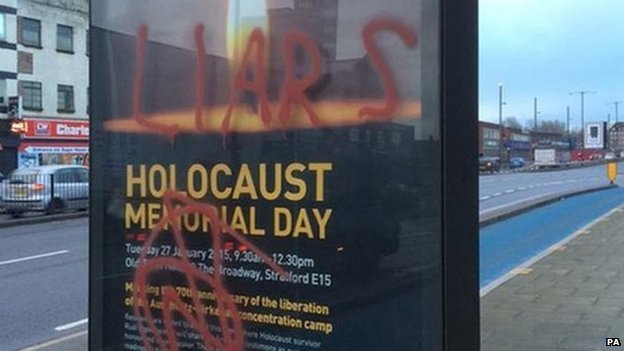 "Posters advertising a Holocaust memorial event in east London have been daubed with graffiti including the words ""liars"" and ""killer"""