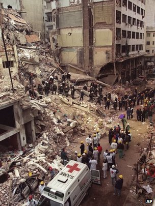 File photo from 18 July 1994 showing rescue workers searching the rubble of the Argentine-Israeli Mutual Association community centre after a car bomb exploded