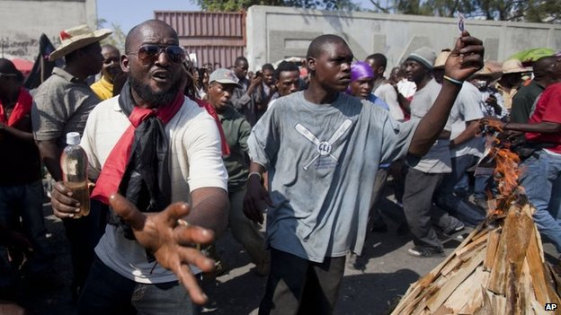Demonstrators take part in a march demanding the resignation of President Michel Martelly in Port-au-Prince on 16 January 2015