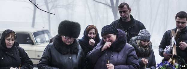 Mourners at the funeral of a child near Donetsk, 20 January