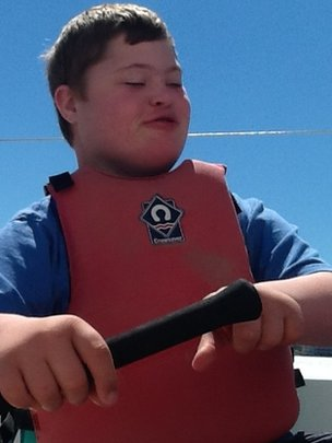Stan rowing a boat