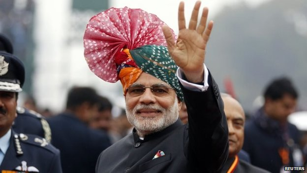 Prime Minister Narendra Modi waves to the crowd at the Republic Day parade in Delhi January 26, 2015
