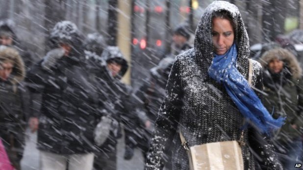 Pedestrians make their way through snow in New York