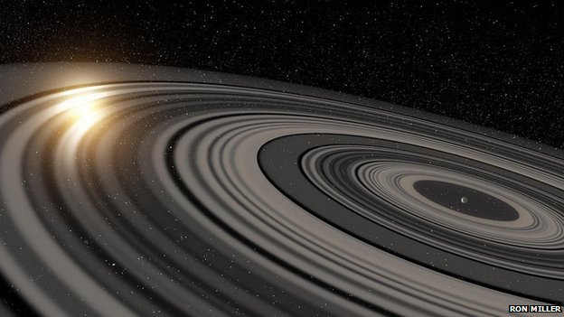 Artist's impression of light grey rings surrounding a planet