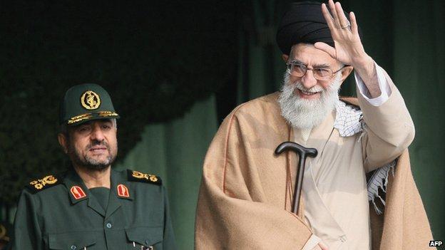Iran's Supreme Leader Ayatollah Ali Khamenei (R) waves while standing next to Guards' commander-in-chief Gen Mohammad Ali Jafari in Tehran (26 November 2007)