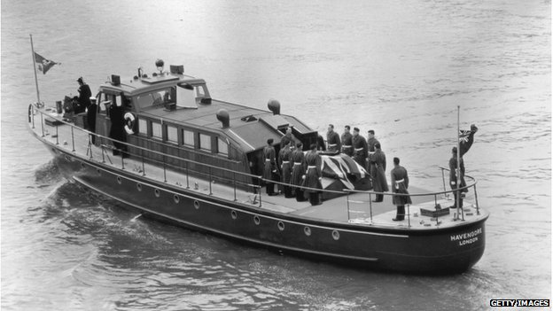The Havengore carrying Sir Winston Churchill's coffin along the Thames