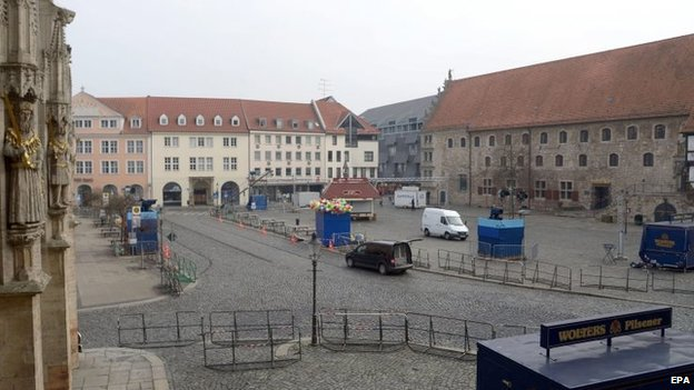 The square is sealed off in Braunschweig, Germany, on Sunday after the annual carnival procession was cancelled shortly before it was due to begin over fears of a terrorist attack