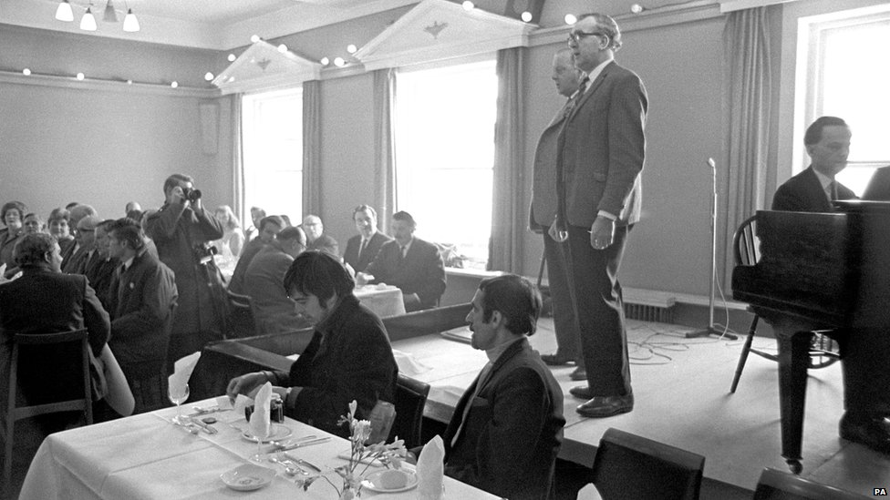 Arthur Frogatt and Arthur Chadwick sing the Ashbourne Football Song during the Shrovetide luncheon in 1969