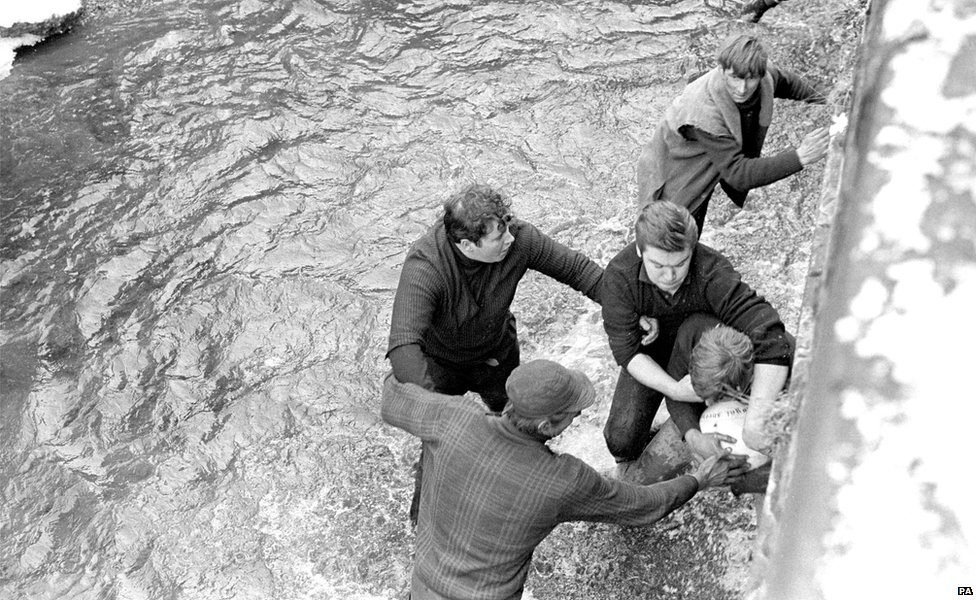 Competitors grapple for the ball in Henmore Brook during the Shrovetide football match in Ashbourne 1969