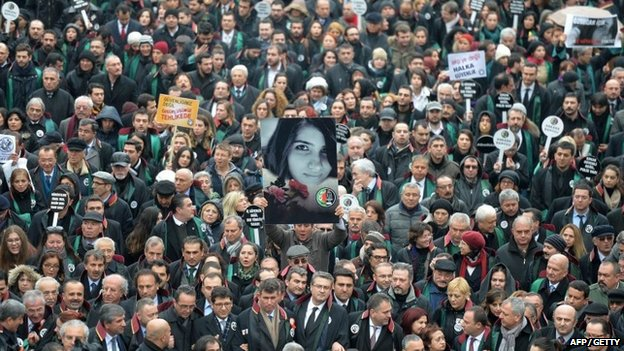 A man holds a poster depicting slain Ozgecan Aslan during a march of members of Turkey's Bar Association in Ankara on 16 February 2015