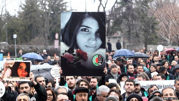 A Member of Turkey's Bar Associations holds a poster depicting slain Ozgecan Aslan, in Ankara, on 16 February 2015