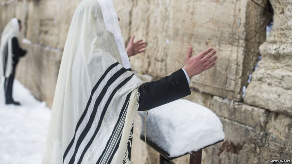 Israelis seen praying at the western wall in the snow on February 20, 2015 in Jerusalem, Israel.