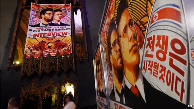 Movie posters for the premiere of the film 'The Interview' at The Theatre at Ace Hotel in Los Angeles, California on December 11, 2014.