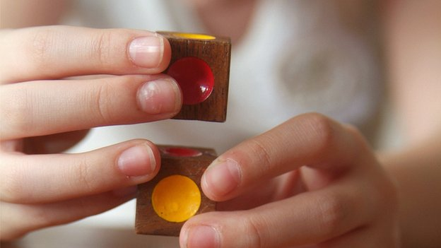 autistic girl playing with blocks