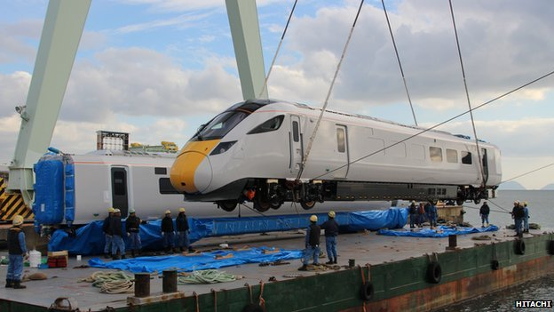 The Hitachi 800 training carriage is lifted off a boat