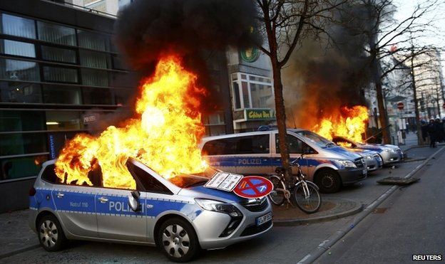 German police cars set on fire by anti-capitalist protesters