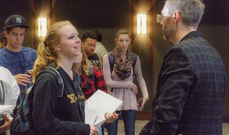 Andrea Kautz speaks to a Belmont student.