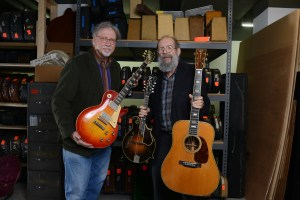 "George Gruhn and Doug Howard hold a 1923 Gibson F-5 Lloyd Loar mandolin, 1960 Les Paul Standard ""Burst"" electric guitar and 1939 Martin D-45 acoustic guitar that have been donated to Belmont University at Gruhn Guitars in Nashville, Tenn. November 8, 2016."